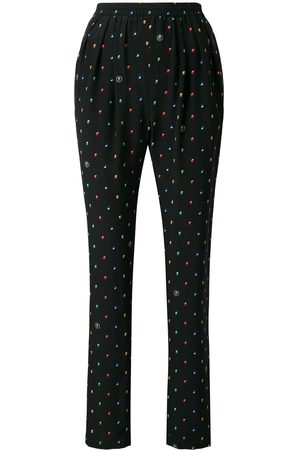 Stella McCartney Women Pants - All-over print trousers