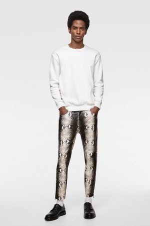 Zara Snakeskin print faux leather trousers