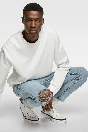 Zara Ripped skinny carrot fit jeans