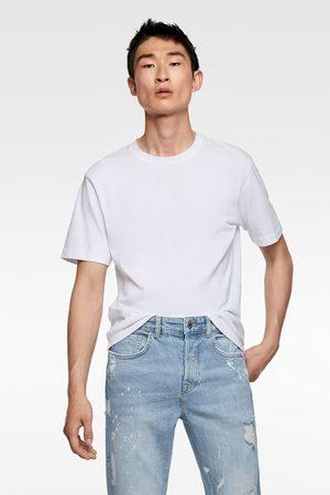 Zara Men Skinny - Ripped skinny jeans with paint splatter