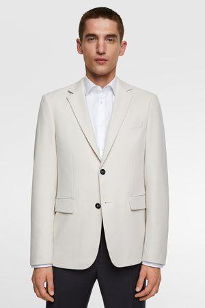Zara 4-way comfort knit textured blazer