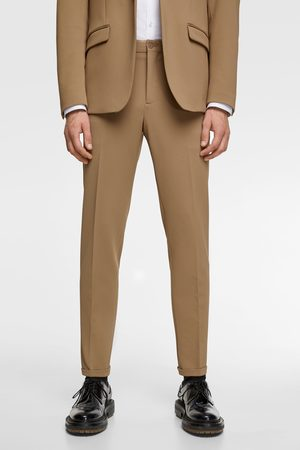 Zara 4-way comfort knit textured suit trousers