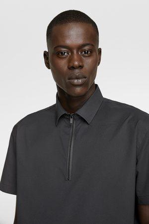 Zara Traveller polo shirt