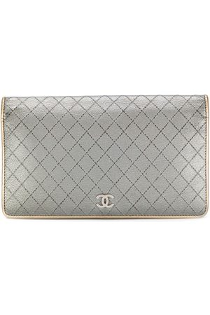 CHANEL Diamond quilted flap wallet