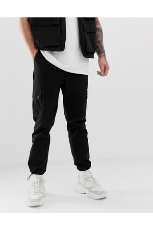 ASOS Tapered cargo trousers in with toggles