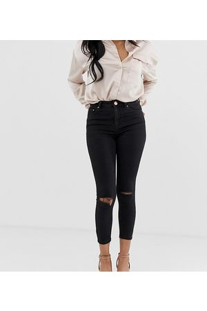 ASOS ASOS DESIGN Petite Ridley high waisted skinny jeans in clean with ripped knees