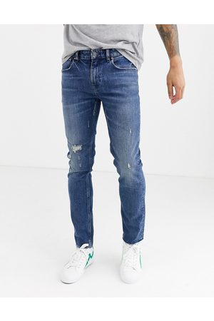 ASOS Cone Mill Denim skinny 'American classic' jeans in mid wash with abrasions and raw hem