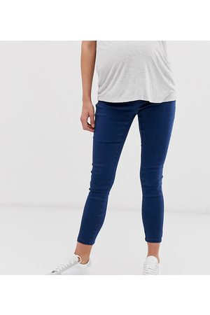 ASOS ASOS DESIGN Maternity pull on jegging in smokey wash with under the bump waistband
