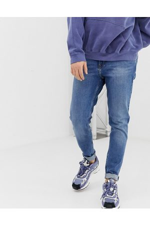 Weekday Cone slim tapered jeans in marfa