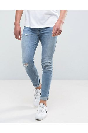 ASOS Super skinny jeans in mid wash with abrasions