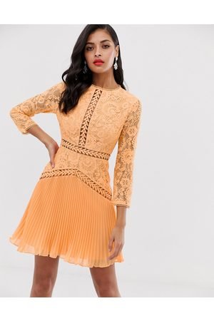 ASOS Lace mini dress with trim inserts and pleated skirt