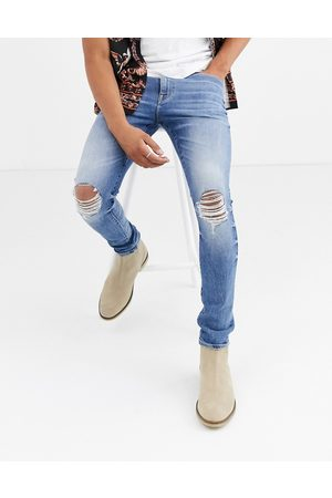 ASOS 12.5oz 'Cigarette' skinny jeans in mid wash with busted knees