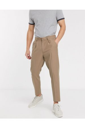 ASOS Tapered crop smart trousers with pleats in