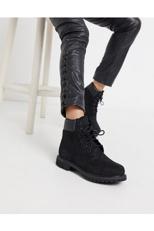 Timberland 6 inch premium lace up flat boots in