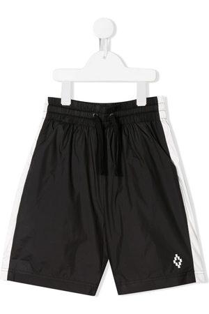 MARCELO BURLON Stripe detail swim shorts