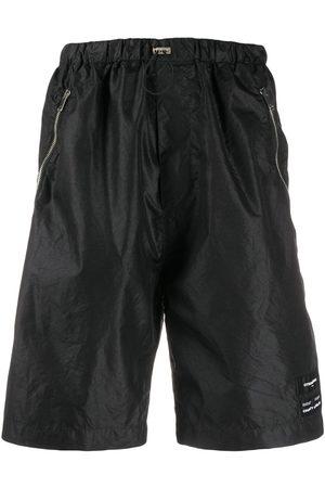 MARCELO BURLON Men Shorts - Drawstring waist shorts