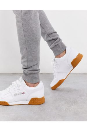 Reebok Workout plus trainers in with gum sole