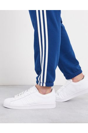 adidas Superstar trainers in triple