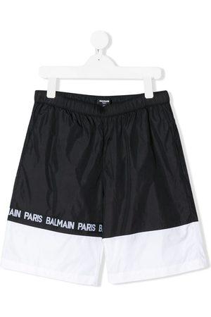 Balmain Monochrome striped logo printed swimming shorts