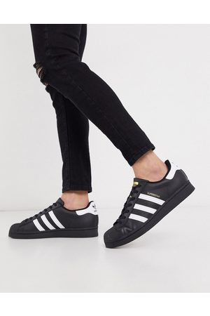 adidas Superstar trainers in