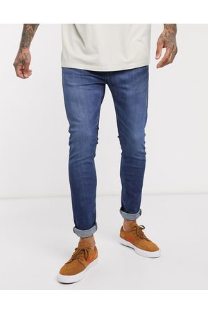 Levi's Levi's Youth 519 super skinny fit hi-ball roll jeans in myers day advanced stretch dark vintage wash