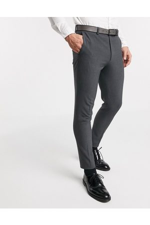 ASOS Super skinny suit trousers in four way stretch in charcoal
