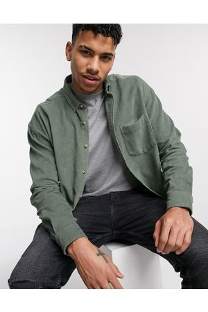 ASOS Oversized 90's style cord shirt in sage green
