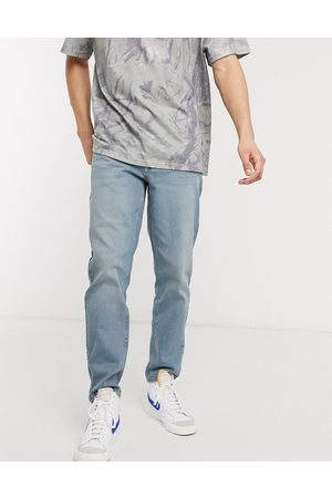 ASOS Men Tapered - Stretch tapered jeans in light wash
