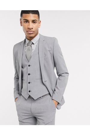 ASOS Super skinny suit jacket in four way stretch in mid