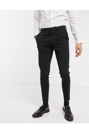 ASOS Super skinny suit trousers in four way stretch in
