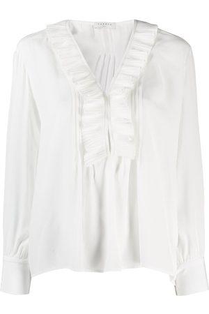 Sandro Ruffle trim blouse