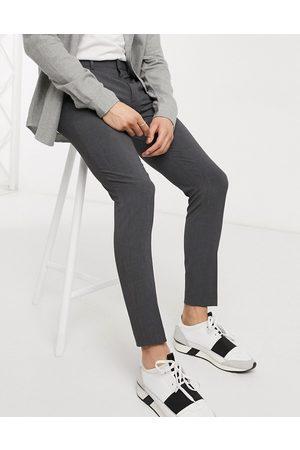 ASOS Men Skinny Pants - Super skinny smart trousers in charcoal