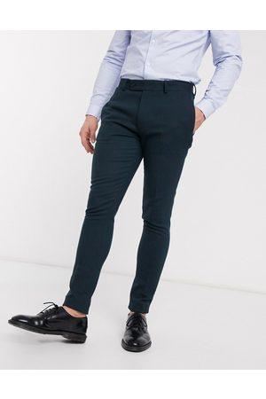 ASOS DESIGN Wedding super skinny suit trousers in dark wool blend twill
