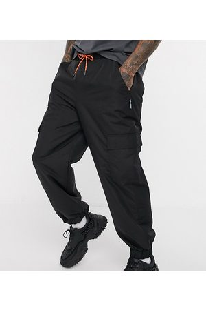 COLLUSION Men Cargo Pants - Nylon cargo trousers with pockets in
