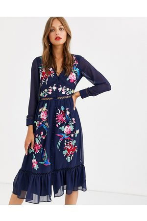 ASOS Embroidered skater midi dress with lace trims and pephem in