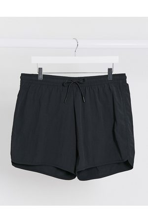 Weekday Tan Structure swim shorts in