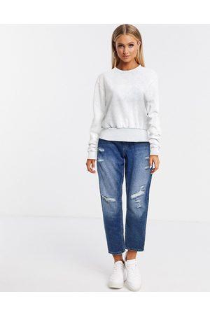 ASOS DESIGN Cropped sweatshirt in wash with chunky rib trim in