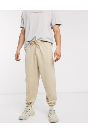 ASOS Organic oversized joggers in -Neutral