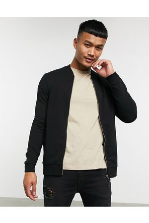 ASOS Muscle jersey bomber jacket in