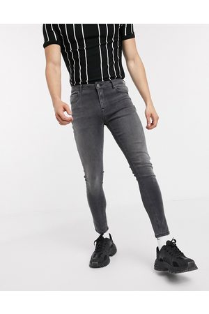 ASOS Men Jeans - Spray on jeans with power stretch in washed