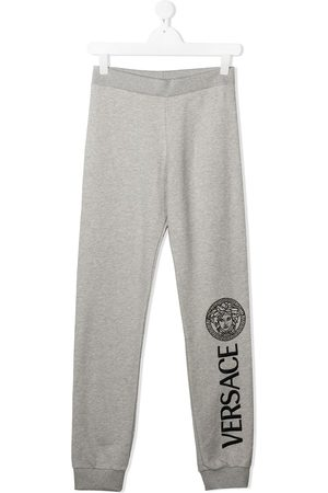 Young Versace Medusa logo track pants