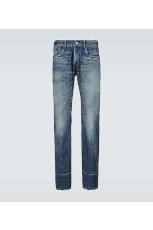 Saint Laurent Slim-fit washed denim jeans