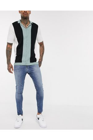 New Look Spray on washed jeans in