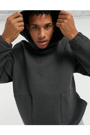 ASOS Oversized hoodie with square pockets in washed