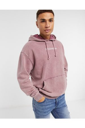 ASOS Oversized hoodie in acid wash and city chest print