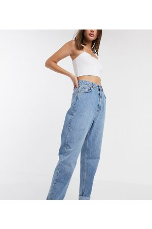 ASOS ASOS DESIGN Tall high rise 'slouchy' mom jeans in midwash