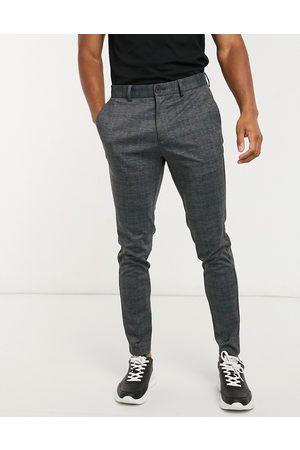 Jack & Jones Intelligence slim fit jersey trousers in dark check