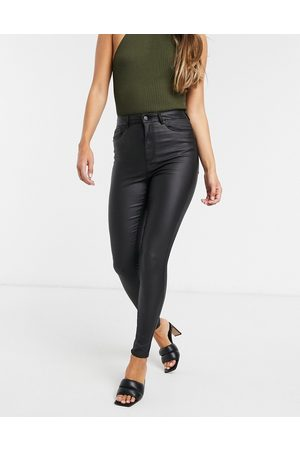 Vero Moda Coated skinny jeans with high rise in