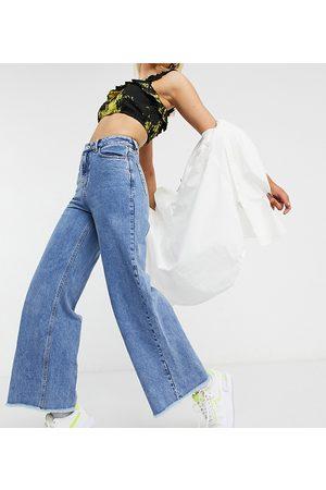 COLLUSION X008 wide leg jeans in stonewash