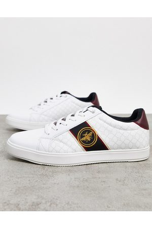 River Island Trainer with wasp embroidery in
